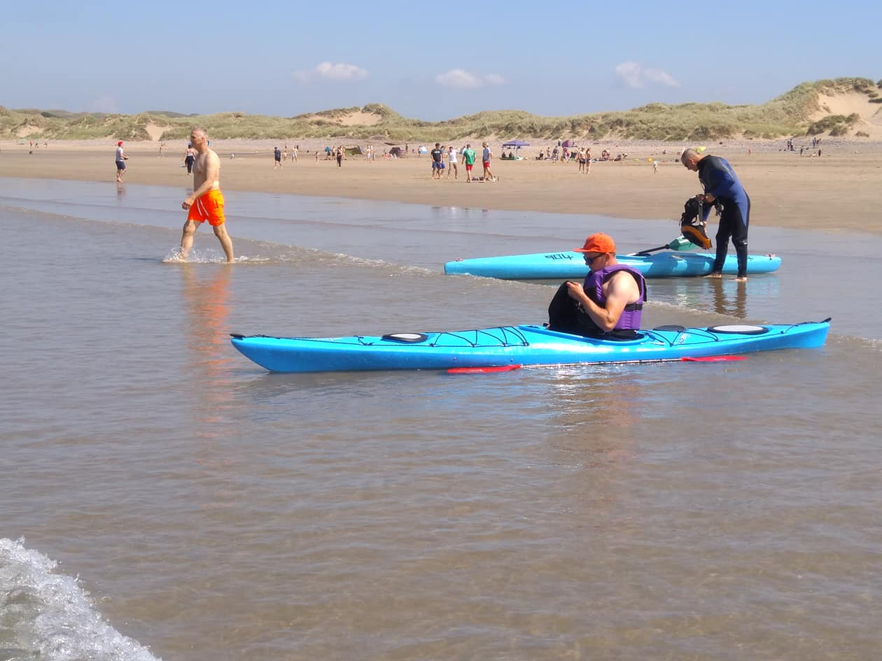 Paddlers on the Gower coast