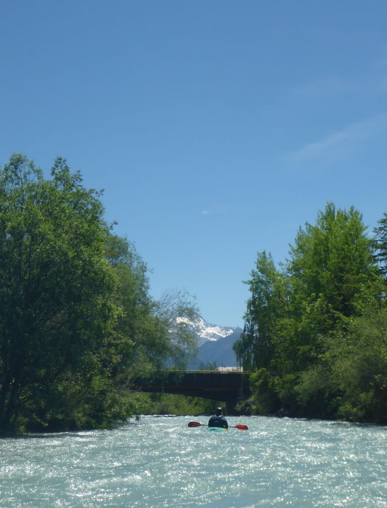 kayaker on quite stretch of river in alps