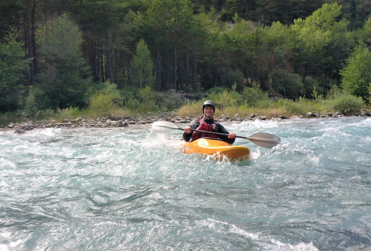 kayaker on Alps river