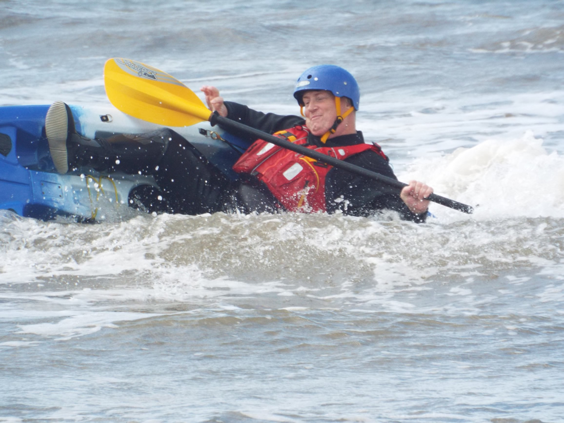 Paddler making a low support stroke