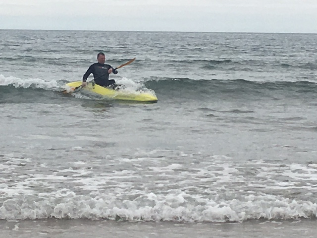 Kayaker surfing